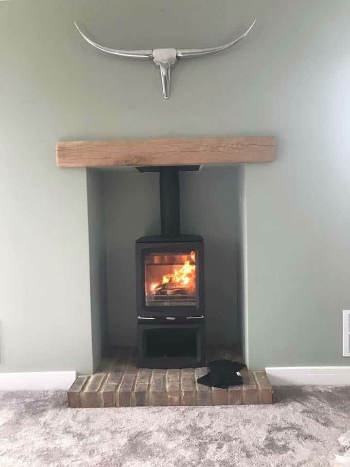 Stovax vogue 5kw wood stove with log store and chimney liner in meopham kent