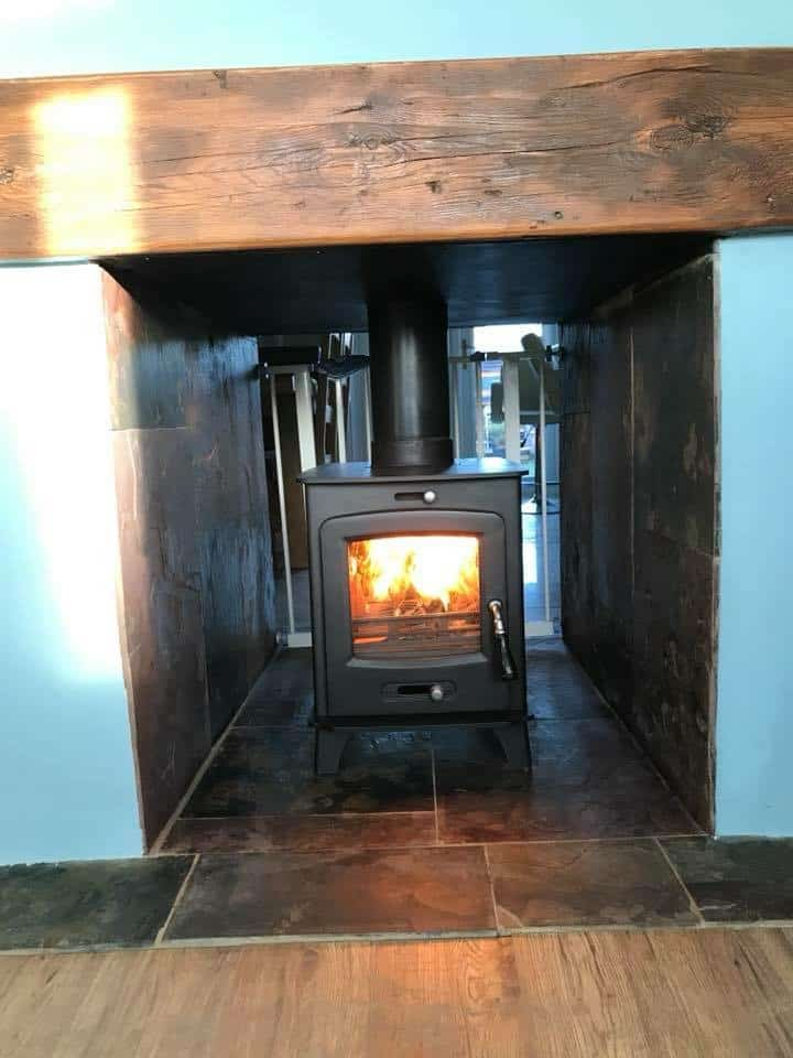 Double sided Ecosy stove and chimney liner installed in broadstaris kent